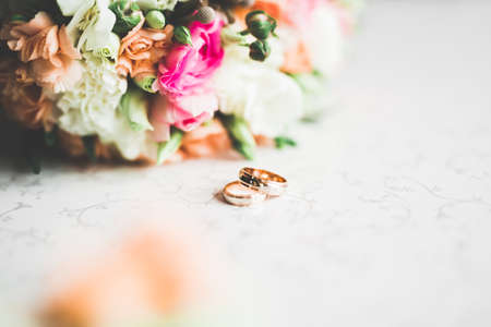 Two golden wedding rings isolated background concept.