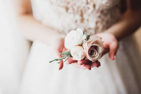Bride holding big and beautiful wedding bouquet with flowers Фото со стока
