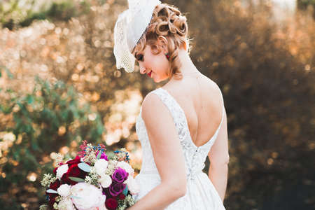 Bride holding big and beautiful wedding bouquet with flowers Stockfoto