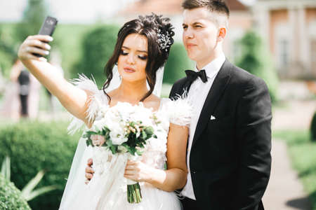 Young wedding couple taking a selfie of themselves