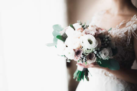 Bride holding big and beautiful wedding bouquet with flowers Standard-Bild