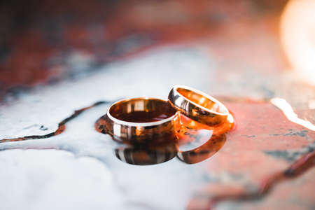Beautiful toned picture with wedding rings Standard-Bild