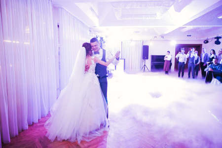 Beautiful wedding couple just married and dancing their first dance