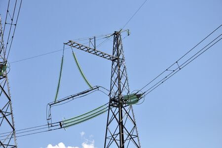 Power transmission lines on the background of the blue sky photo