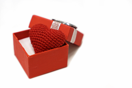Valentine gift box with red knitted hearts . Love concept Banco de Imagens