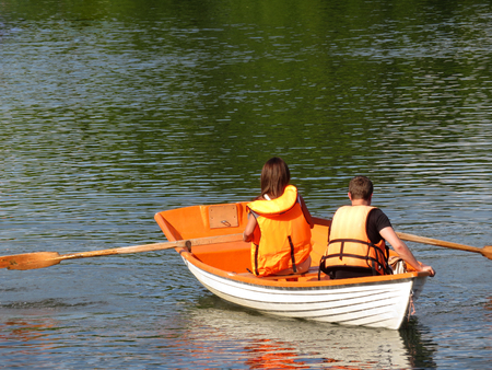 Couple in a life jackets on a summer lake. Safety date