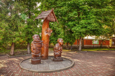 Park of wooden sculptures in Bryansk. Wooden sculpture composition at the entrance to the public Park-Museum of Alexey Tolstoy. Bryansk, Russia-July 2020