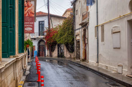 On one of the streets of the Old city. Urban landscape. A narrow stone street in the area of Larnaca. The old part of the city of Larnaca, a street with vintage buildings. Larnaca, Cyprus-March 2019