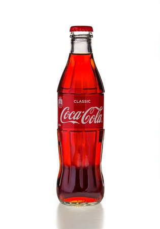 Classic glass Coca-Cola bottle with a volume of 0.33 liters isolated on a white background. Moscow, August, 2020