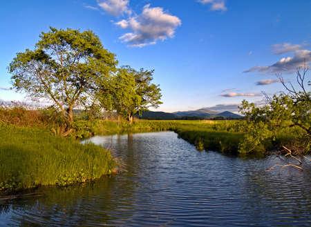 The Year landscape with lake on sundown     Stock Photo