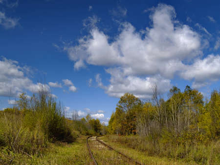 A summer landscape with an old railway track Stock Photo