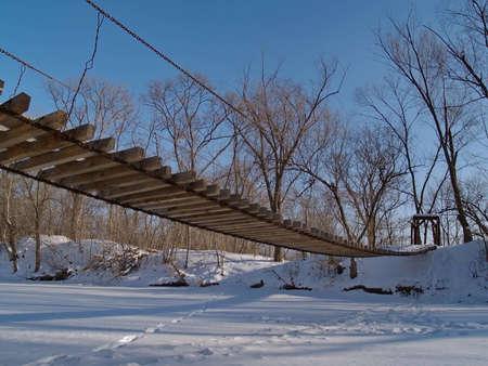 ussuri: Suspension bridge, Russia, river Ussuri Stock Photo