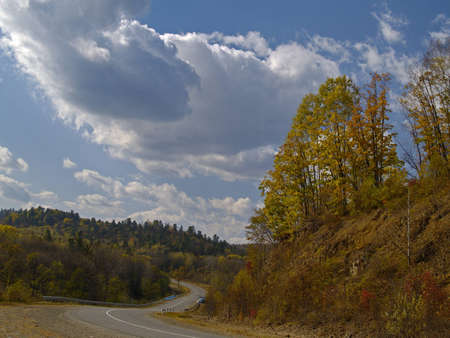 A landscape mountain road to an autumn wood Russia    photo