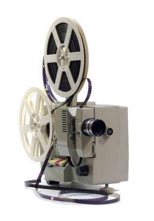 An ancient film projector on a white background       photo