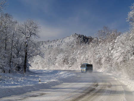 A winter landscape with road and a wood Stock Photo