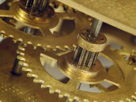 Fragment of a clockwork golden colour close up photo