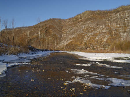 ussuri: Winter landscape with the river at a mountain slope Stock Photo