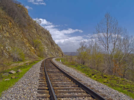 The Tumbling of railway linen beside declivity of mountain