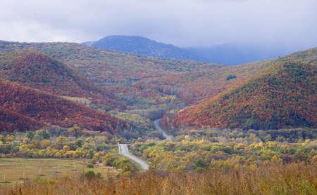 Autumn landscape with a kind on mountain ridge