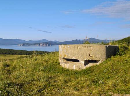 Old artillery strengthening on high sea coast