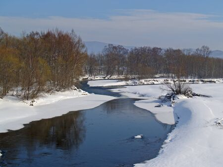 ussuri: Winter landscape with the river and snow-covered coast