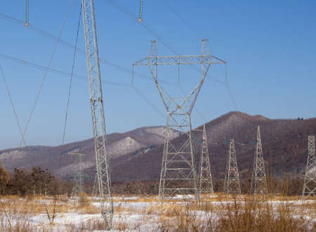 Landscape with tower of a high-voltage electric main Stock Photo
