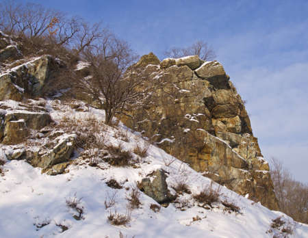 Winter landscape with the rock covered  snow