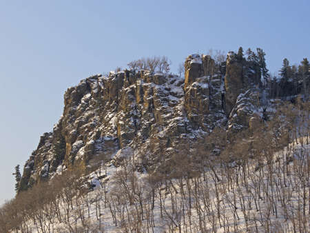 Rocks at mountain top in the winter morning photo
