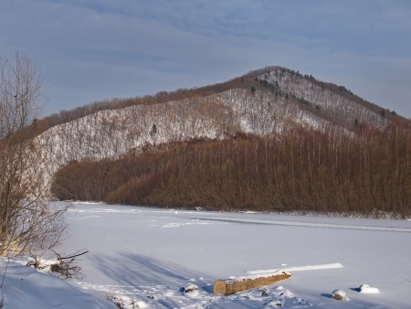 ussuri: Winter landscape with the frozen river at a mountain slope