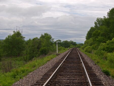 Summer landscape with a lonely railway track