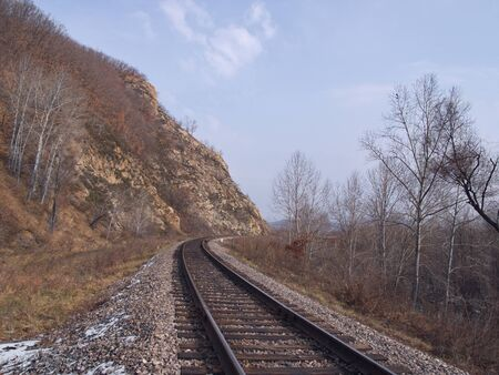 Autumn landscape with railway tracks