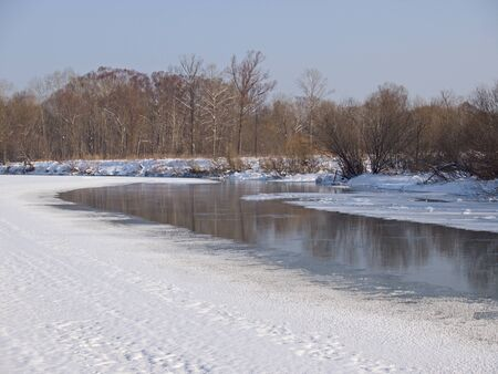 Winter landscape with the river bank