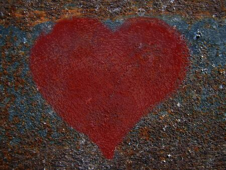 Figure heart on rusty metals                          photo