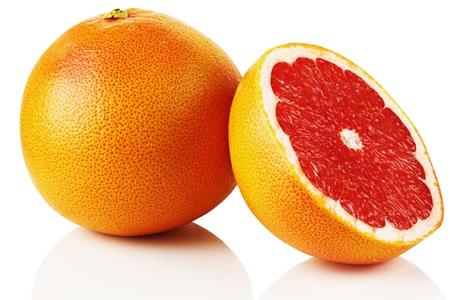 Ripe fresh grapefruit on white background. photo