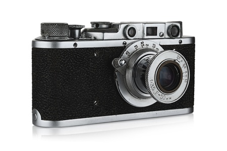 The old camera on a white background. Stock Photo - 12507374