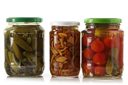 Pickled cucumbers, tomatoes and mushrooms on a white background  photo