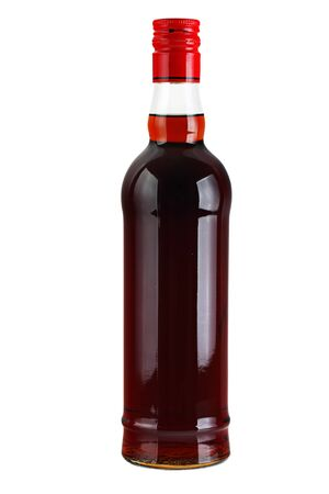 Alcoholic beverage in a glass bottle isolated on a white background. photo