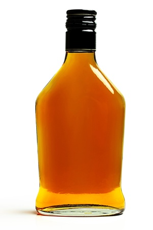 A bottle of brandy on a white background. photo