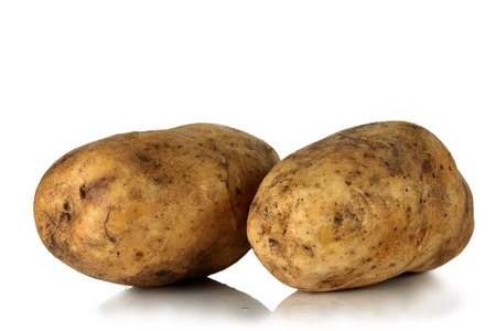 Large fresh potatoes on a white background. photo