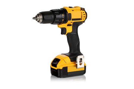 Cordless driver drill on a white  photo