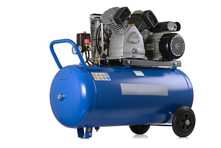 air pressure: New air compressor on a white background. Stock Photo