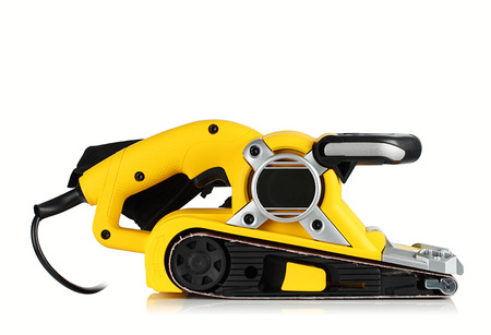 electric material: Electric sander  on a white background. Stock Photo