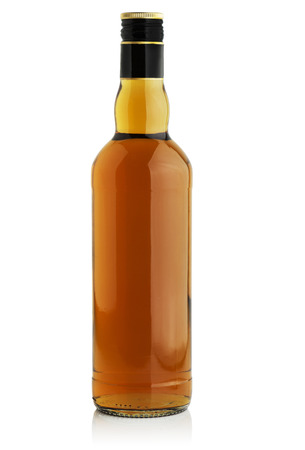 Bottle with alcohol on a white background Фото со стока