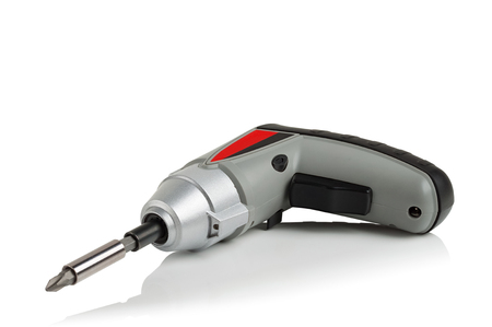 new compact electric screwdriver on white background Stock Photo