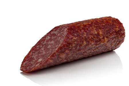 salame: piece of smoked sausage on a white background Stock Photo