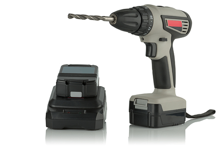 tool chuck: Cordless drill screwdriver with drill and charger on a white background.