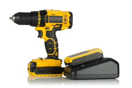 a drill: Rechargeable and cordless drill on a white background. Stock Photo