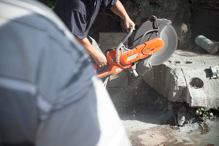 cutting of reinforced concrete structures with a diamond saw Stock Photo