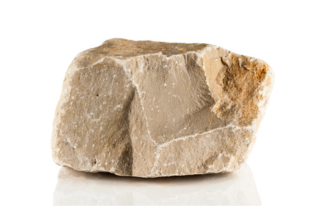 the piece of limestone on a white background
