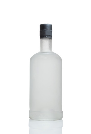 Frosted vodka bottle with reflection on white background Stock Photo